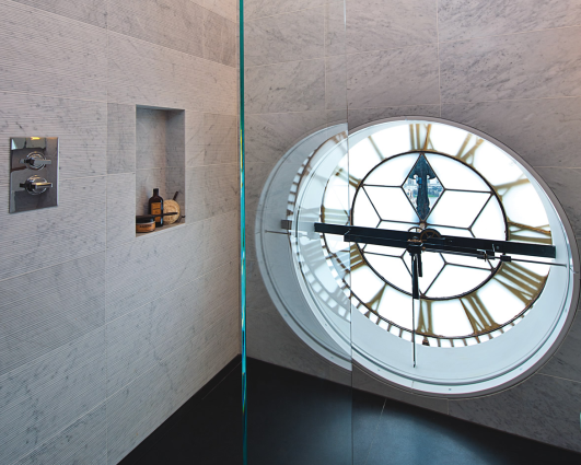 A bathroom located in the clock tower affords south facing views through the workings of the still-functioning clock