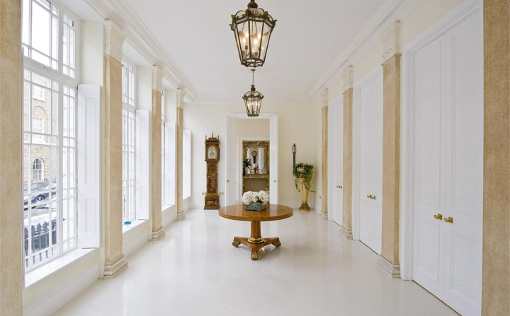 The ground floor Hall, opens onto an adjoining Reception Room and Dining Room