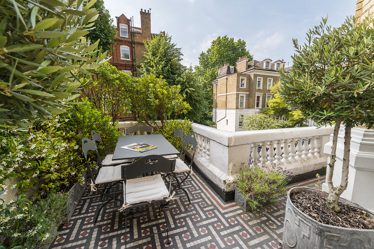 The south facing terrace is accessed directly from the Drawing Room and comfortably seat six