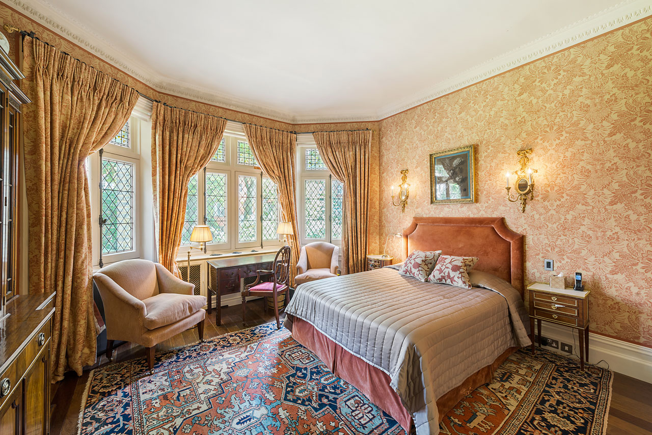 The bedroom with mullioned windows faces onto communal gardens (to which the flat has access) so is extremely quiet and has a green and leafy aspect.