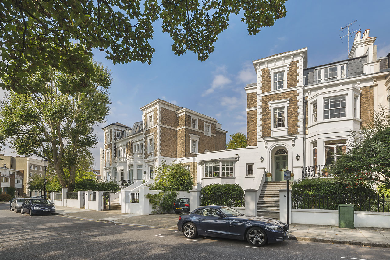 The house sits on a wide, tree-lined street in one of Notting Hill's premier addressed
