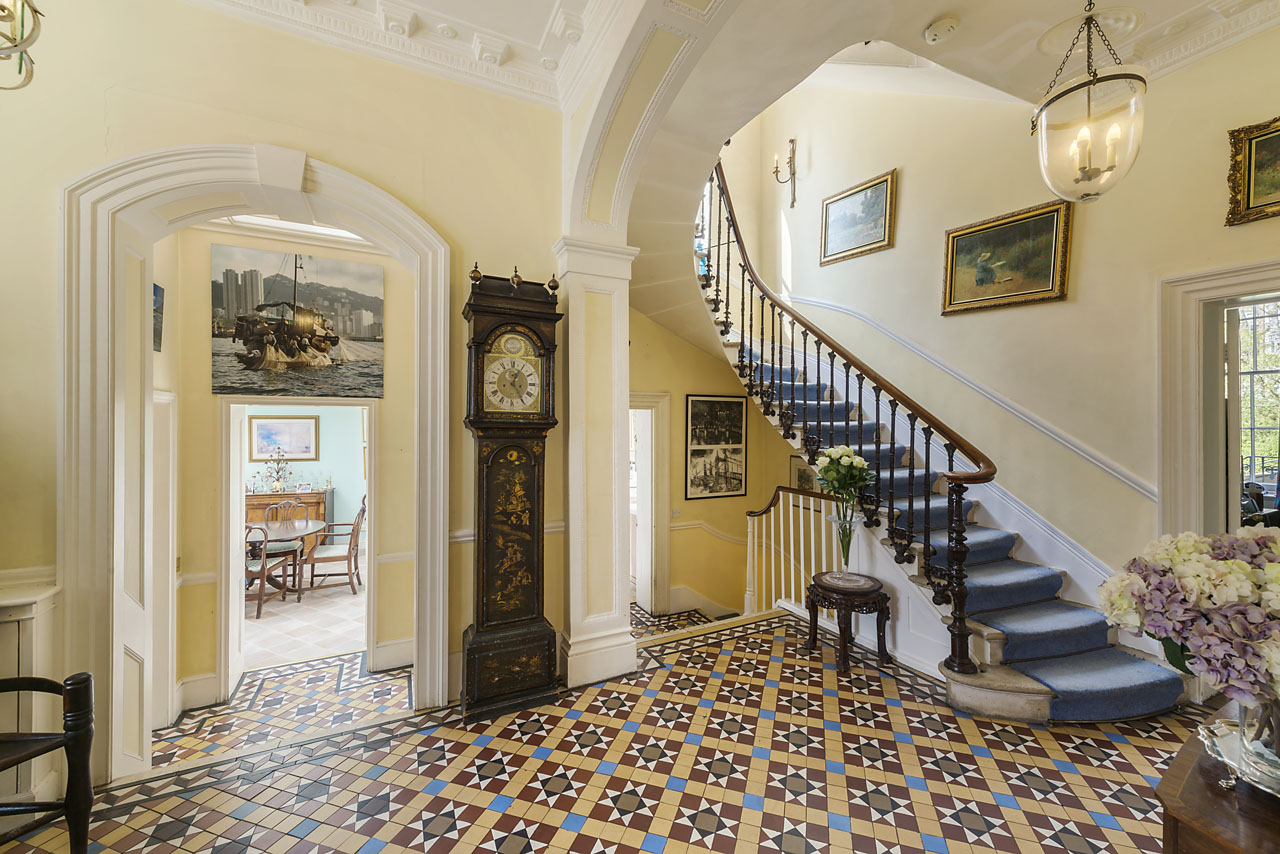 The entry hall retains its original Victorian floors and a lovely and gracious staircase  leads to the upper floors